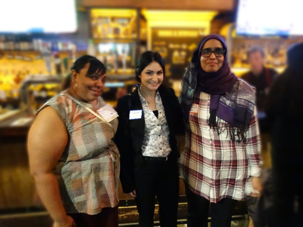 Three women posing together at networking reception venue