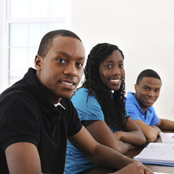 Group of young students in classroom