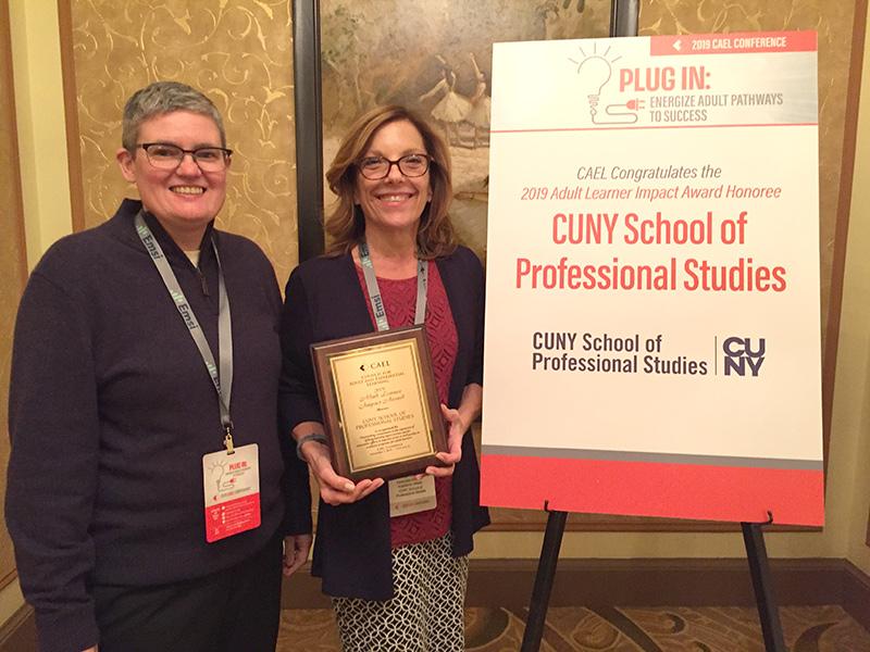 Dr. Jennifer Sparrow holding Adult Learner Impact Award reward accompanied by Holli Broadfoot.