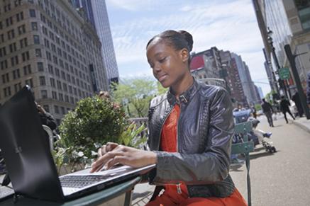 Girl sitting outside on laptop