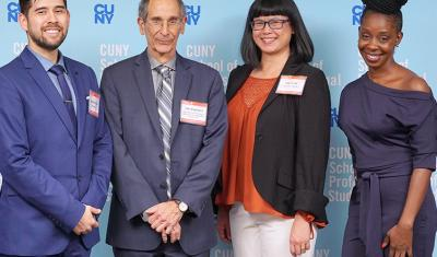 Three student scholarship recipients are joined by Dean John Mogulescu.