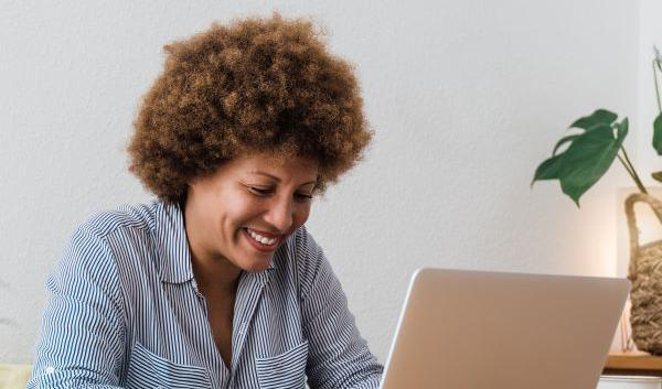 happy-african-mature-woman-using-laptop-computer
