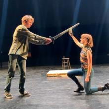 "Miles the Doppelganger, played by Hayden Palmer, fights Agnes, played by Claire Schnatterbeck, in a Sheridan High School Drama Club rehearsal of ""She Kills Monsters."" (Grace Cannon)"