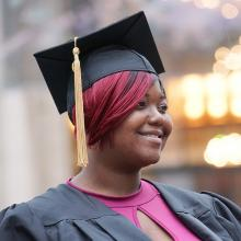 CUNY SPS Graduate Smiling