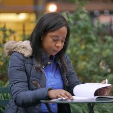 CUNY SPS student studying outdoors in NYC park