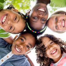Kids in a circle smiling