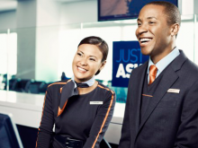 A female and male airline customer reps