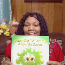 Kadeatrice holding children's book