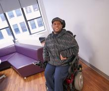 Photo of Leonard Blades sitting in wheelchair at CUNY SPS
