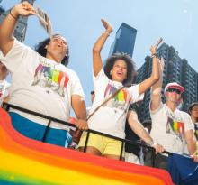 People on a float at the NYC Pride Parade