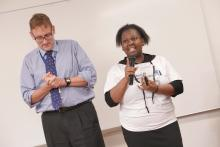 Current CUNY SPS student Shakima Williams-Jones. Description: Woman accepting award at the annual Spring Reception