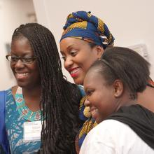 Three African American female students taking group photo at on-campus event